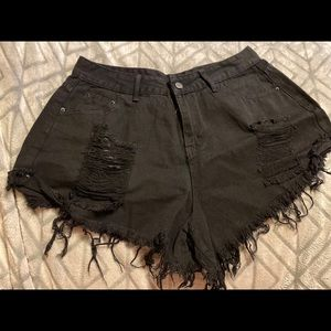 Women's distressed denim shorts